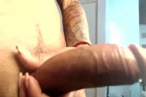 Tattooed tranny Inanna Playing Her cock